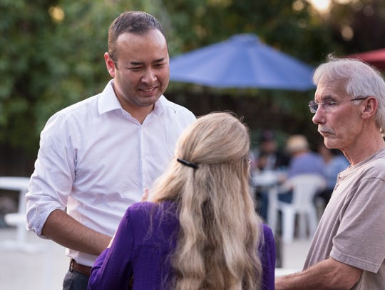Democratic congressional candidate Andrew Janz, left,