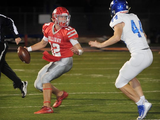 Holliday quarterback Kade Patterson (12) looks for