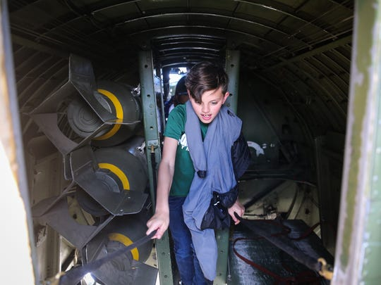 Evan Barta, 12, from Cornerstone Christian School walks through the B-17 Flying Fortress during the Wings of Freedom tour Tuesday, April 3, 2018, at San Angelo Regional Airport.