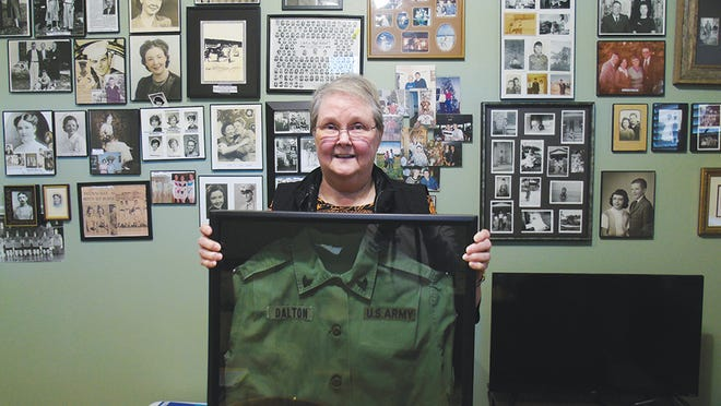 Linda Dalton Rider, today with her photo memories and uniform