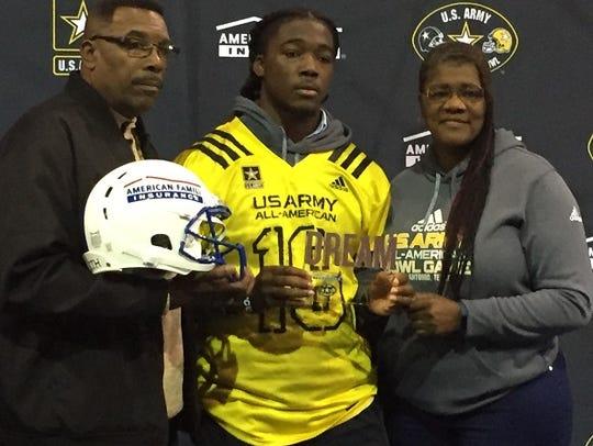 LSU commit Micah Baskerville stands with his parents,