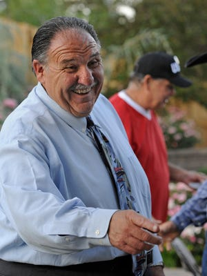 Mayoral candidate Ray Pezonella mingles with family and friends in his Reno home on election night on June 10, 2014.
