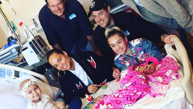 """Brain cancer patient Teiya Camille Van Meter, 5, was surprised with a visit by the judges of """"The Voice"""" at the Children's Hospital of Los Angeles in California."""