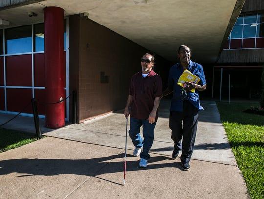 Tom Jones assists Enrique Alva, left, after a visit