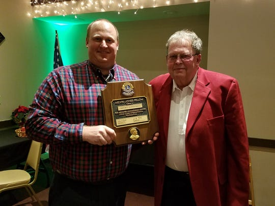 Lomira Lion Lawrence Schraufnagel, right, receives Melvin Jones from Lomira Lions President Peter Kuen, left.