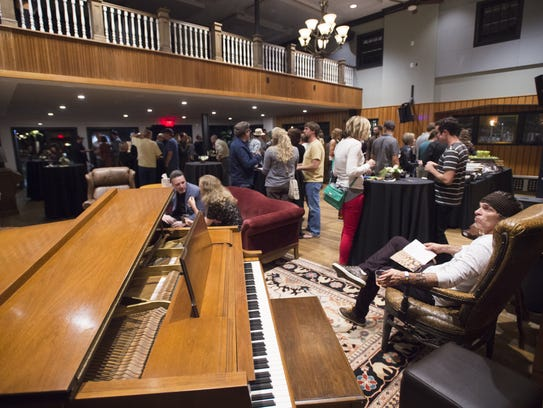 People attend the Music District opening party Friday,