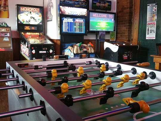 """Golden Tee Live 2015"" and a ""Monopoly"" pinball machine are the crown jewels of the Slippery Noodle Inn game room in Downtown Indianapolis."