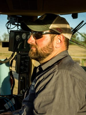 Scott Thomas manages Eager Farms, Inc., and farms his family's land.