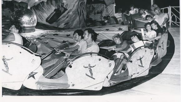Visitors enjoying fair attractions in 1987!