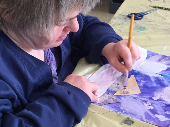 Kathy Sery colors during art class at Pegasus the Arts
