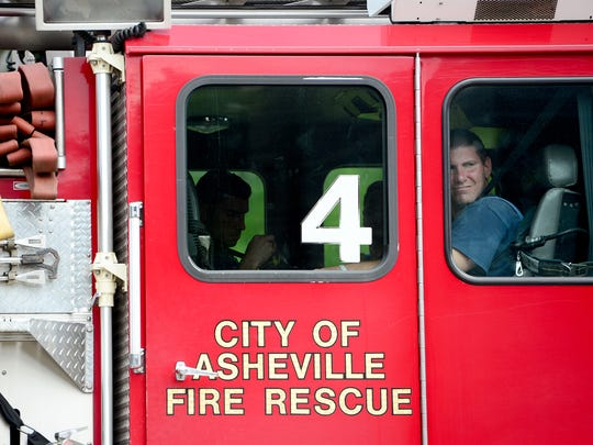 About 160 city employees including Asheville firefighters are paid less than $15 an hour. The City Council is debating how best to increase their compensation.