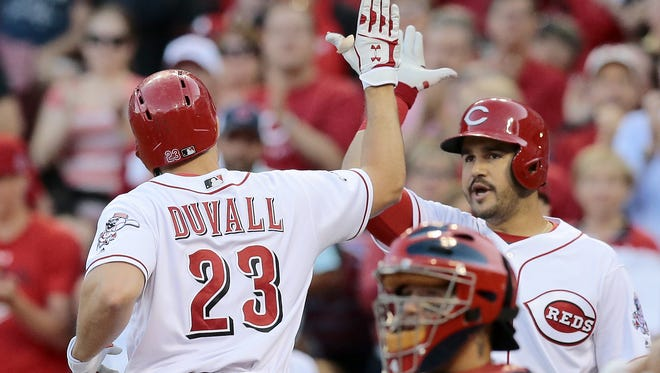 Cincinnati Reds left fielder Adam Duvall (23) is high-fived after hiting a three-run home run in the bottom of the fourth inning of the MLB National League game between the Cincinnati Reds and the St. Louis Cardinals at Great American Ball Park on Tuesday, June 7, 2016. After four innings, the Reds led 4-1.