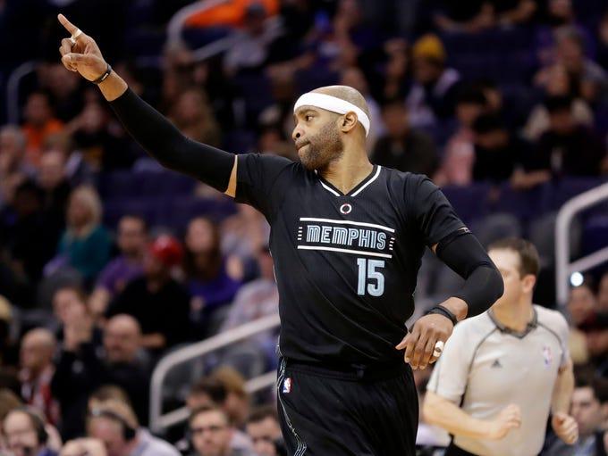 Memphis Grizzlies guard Vince Carter (15) points after