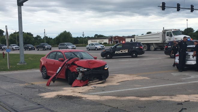 Police work to clear a crash at the intersection of Mormon Trek Boulevard and South Riverside Drive on Monday morning.