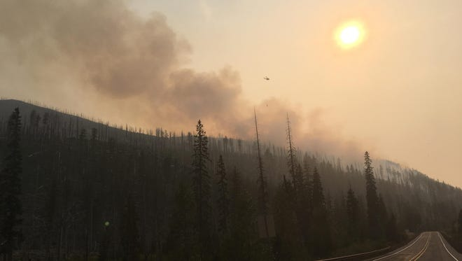 Smoke rises from the Potato Hill Fire near Highway 18 in the Santiam Pass on August 29, 2017.