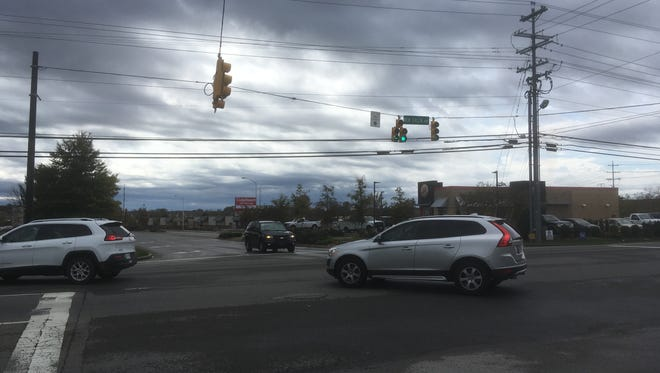 Drivers turn left from Cason Lane onto New Salem Highway, which the state plans to widen to five lanes within three years.
