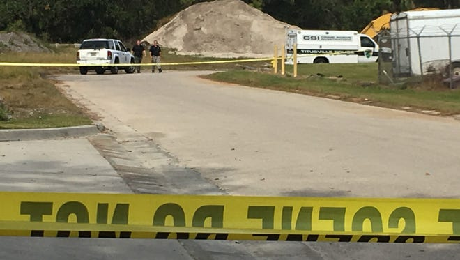 Police investigate a location off Bobbi Lane in Titusville, where a body was discovered Sunday.