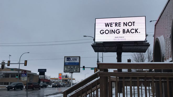 A billboard near 22nd Street and Minnesota Avenue offers support to Planned Parenthood on the 45th anniversary of Roe V. Wade, a U.S. Supreme Court case that legalized abortion.