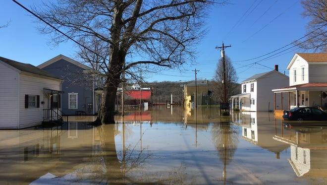 Walnut street is flooded a few blocks into the city after floods have raised the water to dangerous levels on Monday Feb. 26, 2018. Many sections of the neighborhoods are closed and in water.