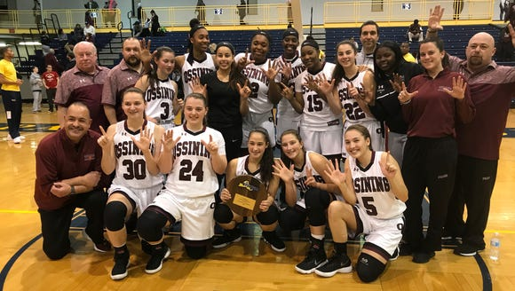 Ossining players pose for a team photo after defeating