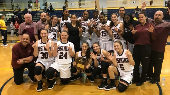Ossining players pose for a team photo after defeating Elmira at Pace University on Friday, March 9th, 2018.