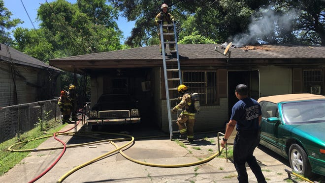 Lafayette firefighters extinguish a fire at a home in the 200 block of Pecan Orchard Road in north Lafayette.