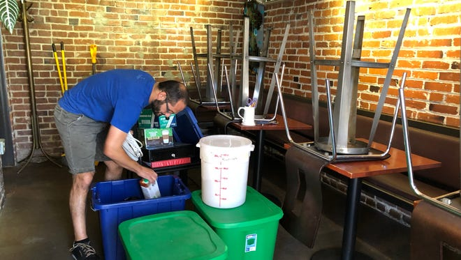 Joe Marino, owner of Nameless Coffee and Tea, packs up the coffee shop in order to sell equipment to The Hub owner, Mark Trujillo.