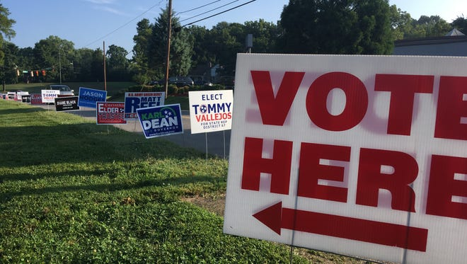 Candidate signs lined the side of Golf Club Lane near the Cumberland Presbyterian Family Life Center voting precinct on Thursday, Aug. 2, 2018.