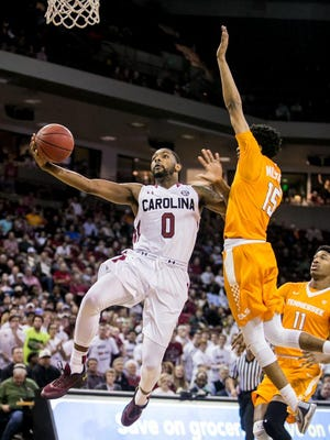South Carolina guard Sindarius Thornwell (0) drives past Tennessee guard Detrick Mostella (15) in the first half at Colonial Life Arena.