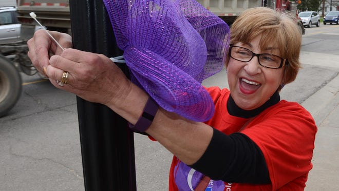 Mary Lou Lopez is part of Team David A. Brandon who were gathering in downtown South Lyon on Saturday to get the word out about this weekend's Relay for Life cancer fundraiser at Millennium Middle School.