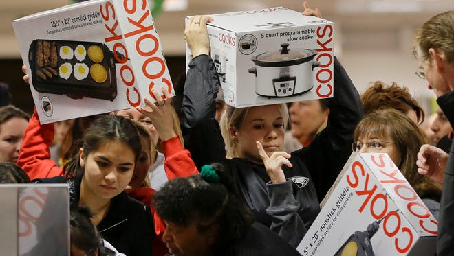 Shoppers rush to grab Black Friday deals at a J.C. Penney store on Nov. 23, 2012, in Las Vegas.