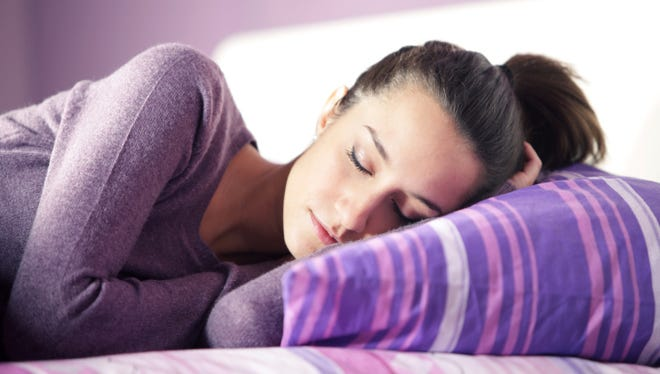 Wearing layers can help you regulate your body temperature while you sleep.