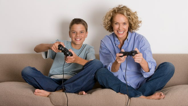 Mother and son playing with game controls