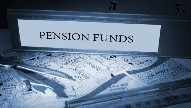 Pension funds on blue business binder.