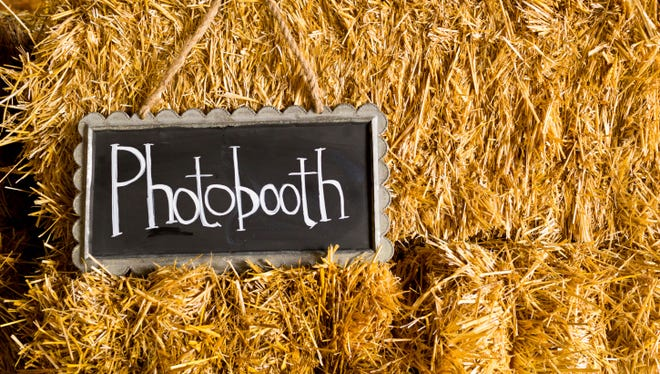 The latest wedding trend doesn't involve hors d'oeuvers or decor, rather an old-school machine: the photo booth.
