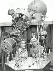 Jane Wallace, left, and Adaline McCullough plan a program