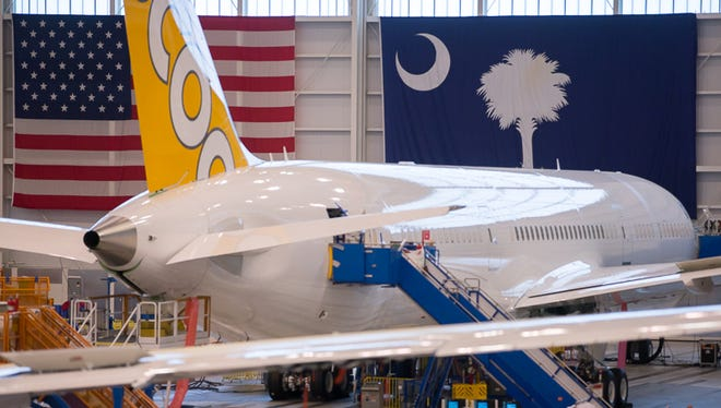 A Boeing 787-10 destined for Scoot rests on the final assembly floor of Boeing's Charleston, S.C., factory on March 25, 2018.