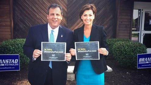 "New Jersey Gov. Chris Christie posed for a ""On duty with Joni"" photo with Iowa Lt. Gov. Kim Reynolds in Davenport during his Iowa visit Thursday, July 17, 2014."