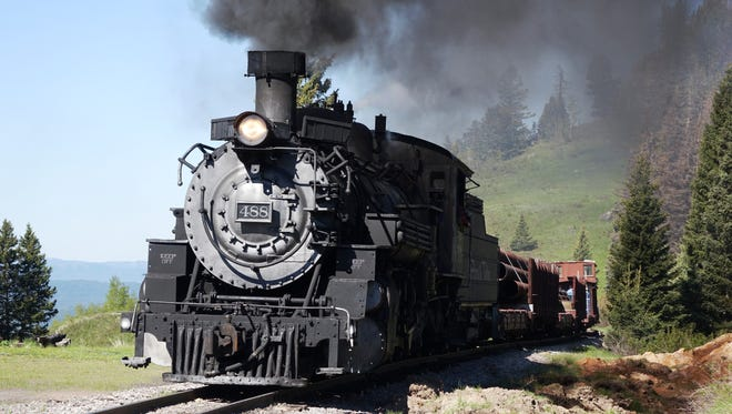 Locomotive 488 smokes and steams as it crests Cumbres Pass on the historic steam-powered Cumbres & Toltec Railroad.