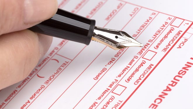 Filling in health insurance form