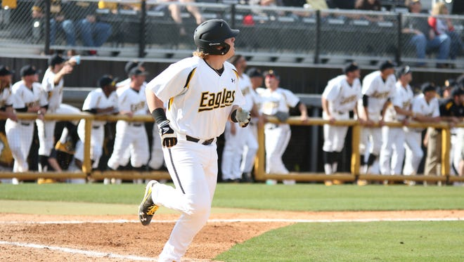 Southern Miss' Taylor Braley watches his home run sail over the left field fence Saturday against Eastern Illinois.