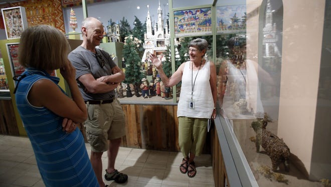 Susan Feiner, right, docent at the International Folk Art Museum, gives Tim and Janet Turner, who moved to Santa Fe two weeks ago, a tour of the Alexander Girard's Multiple Visions exhibit on Tuesday, June 21, 2016. The museum is no longer allowing New Mexicans free admission every Sundays. Now it's only the first Sunday of the month.