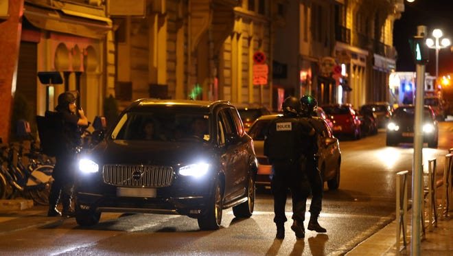Police officers carry out checks on vehicles in the center of the French Riviera town of Nice after a van drove into a crowd watching a fireworks display on July 14, 2016.