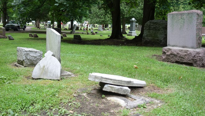 Damaged tombstones from the late 1800s at Ft. Howard Memorial Park.
