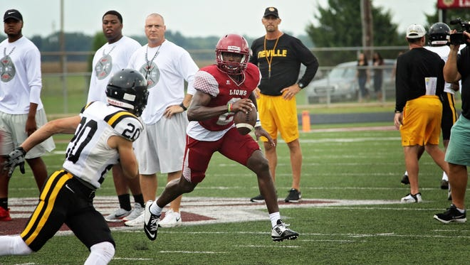 Ouachita's Jabari Johnson (2) carries the ball for the Lions in a scrimmage against Neville last season.