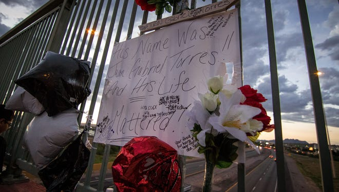 Balloons and flowers adorn the memorial for Juan Gabriel Torres at the Lohman/I-25 overpass bridge site, August 23, 2016.