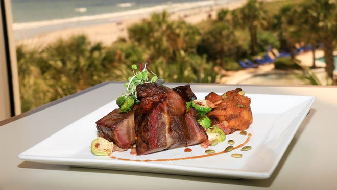 Café Amalfi serves Wagyu Brisket with pumpkin bread pudding, bacon braised brussel sprouts and a spiced bourbon glaze.