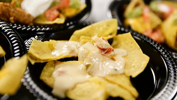 Crawfish queso dip and chips is served during a press