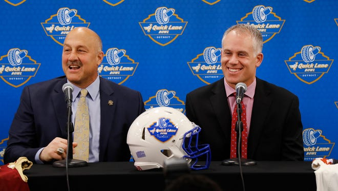 Boston College football coach Steve Addazio, left, and Maryland coach DJ Durkin, right, speak at a news conference previewing the Quick Lane Bowl in Allen Park on Dec. 7, 2016.