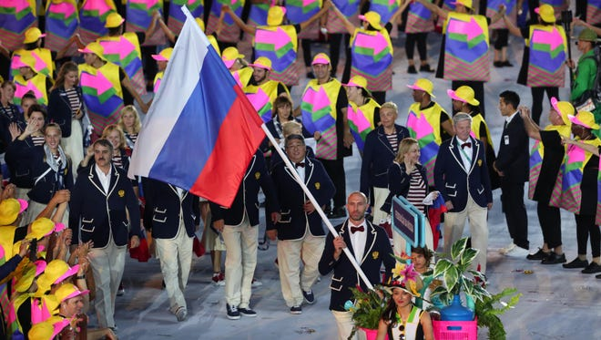 Russia flag bearer Sergei Tetyukhin leads the team into the stadium during the opening ceremonies for the Rio 2016 Summer Olympic Games.